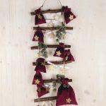 Wandhanger van stokken kerstsfeer